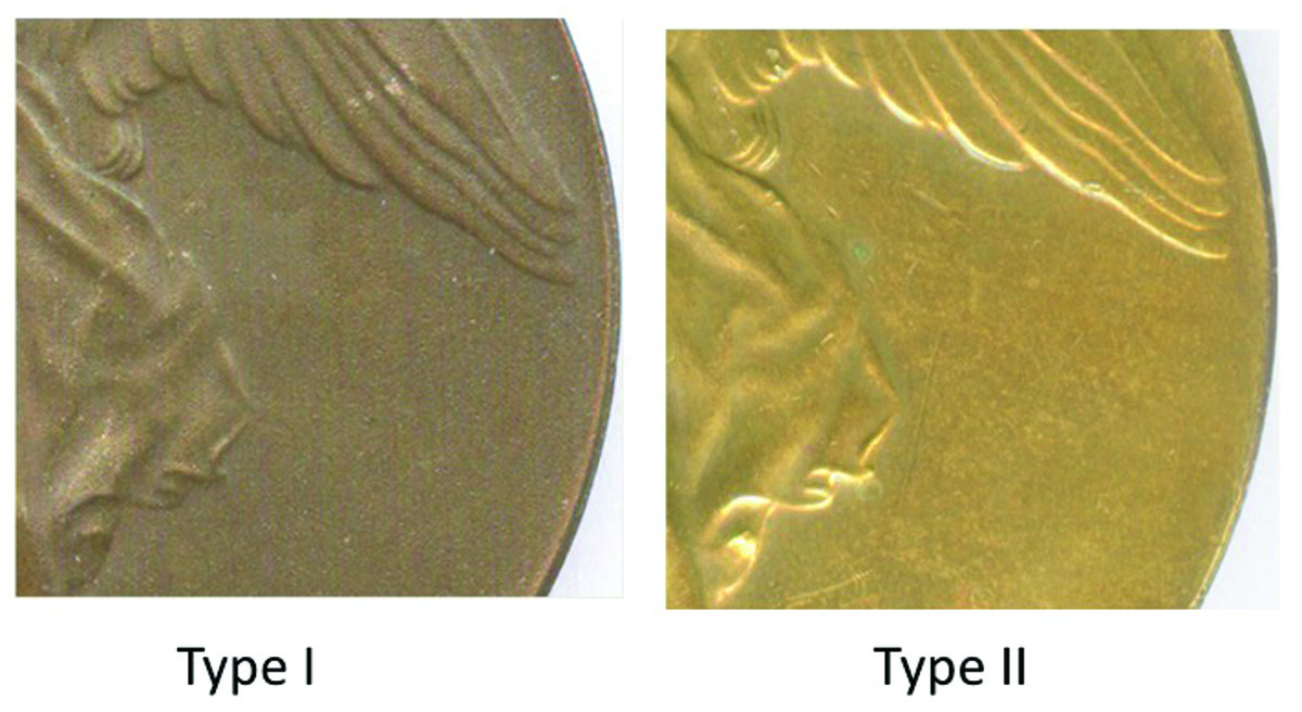 Comparison of the color and medal surfaces of the Type I (left) and Type II (right). The color of the Type I is much darker and its surface appears pockmarked due to sandblasting.