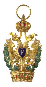 Figure 7: Order of the iron Crown badge with war decoration. Image courtesy of Dorotheum
