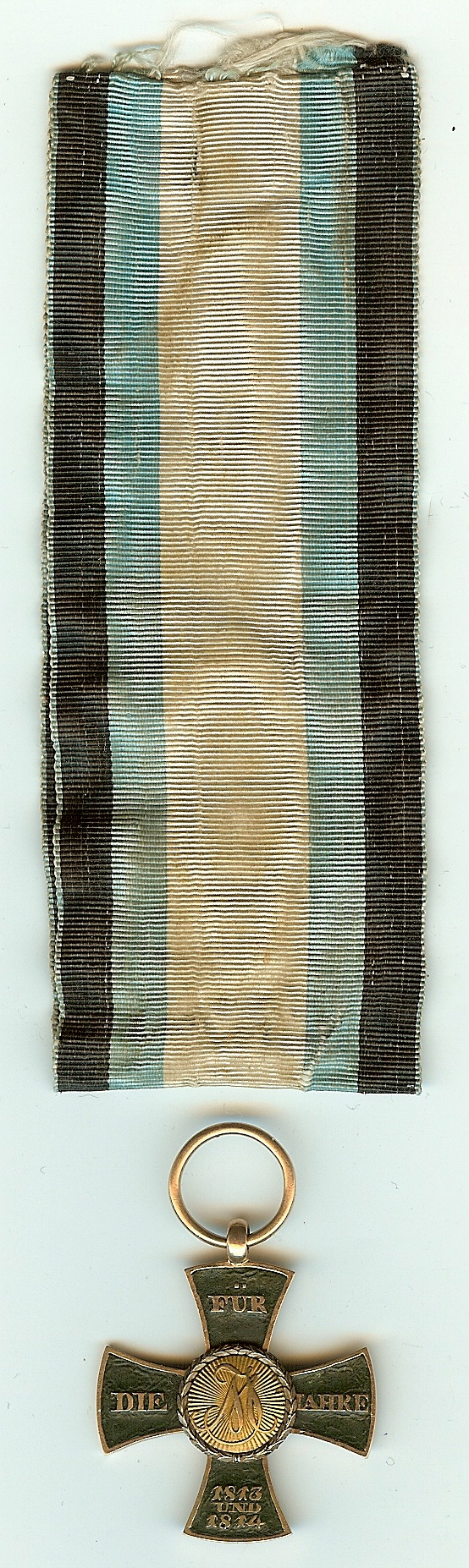 Figure 1: Custom-made cross and ribbon. Image from author's archive.