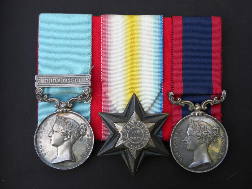 The Medal Group to Lt. Col. Bradshaw York Reilly.