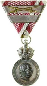 Figure 7: Franz Joseph Silver Military Merit Medal, with swords and third award bar. Image courtesy of Dorotheum.