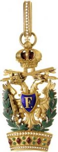 Figure 7: The Order of the Iron Crown, Knight First Class badge with war decoration and swords. Image courtesy of Dorotheum .
