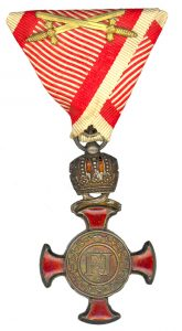 Figure 9: Silver Merit Cross with crown on war ribbon with swords. Image from the author's archive.