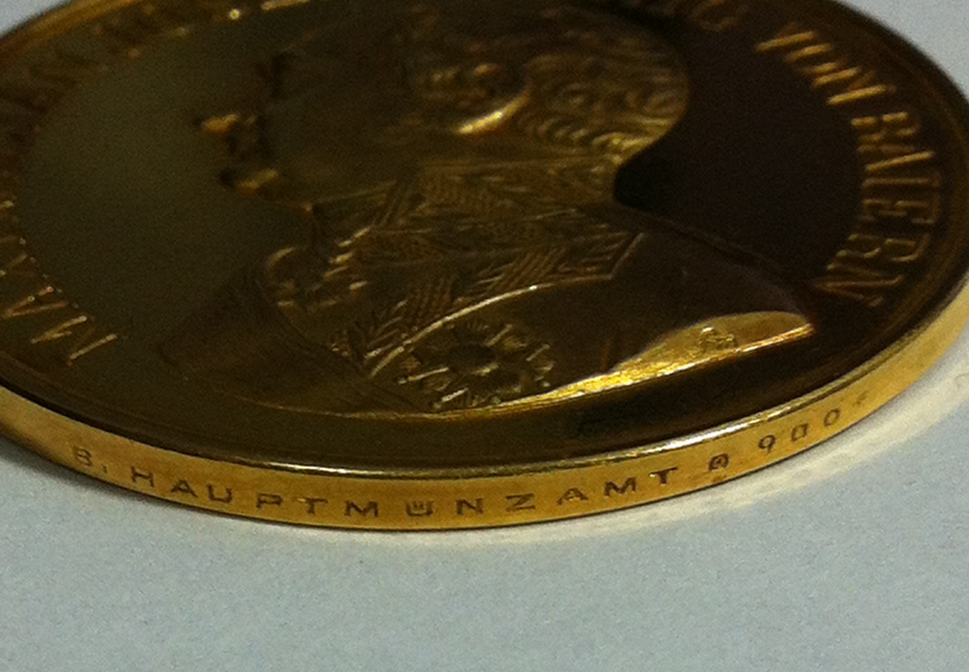 Figure 8-Detail of the Gold Bavarian Bravery Medal showing the die-sinker's mark and edge inscription. Image from author's archive.
