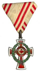Figure 11: Red Cross Decoration with war decoration, second class on tri-fold ribbon as awarded to men. Image from the author's archive.