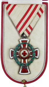 Figure 7: Red Cross Decoration with war decoration, second class case interior. Image from Pinterest