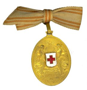 Figure 13: Bronze Red Cross Merit Medal on ribbon as worn on civilian dress. Image from the author's archive.