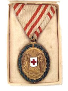 Figure 5: Red Cross Bronze Merit Medal with war decoration on Tri-fold ribbon box, interior. Image from the author's archive.