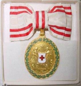 Figure 8: Red Cross Bronze Merit Medal with war decoration on bow box, interior. Image from the author's archive.