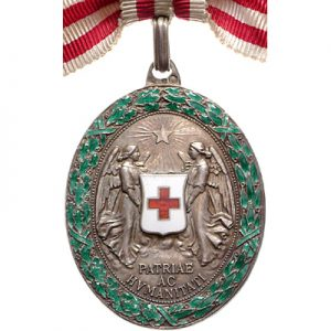 Figure 1: Silver Red Cross Decoration with war decoration.  Image courtesy of  Dorotheum.