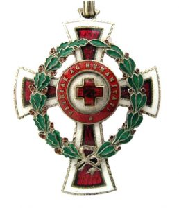 Figure 22: Red Cross Decoration first and second class with war decoration. Image courtesy of Dorotheum