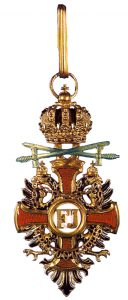 Figure 11: The Order of Franz Joseph, Commander badge with war decoration, and swords of a lower class. Image from the author's archive.
