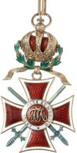 Figure 4: The Order of Leopold, Grand Cross with war decoration, and swords of a lower class. Image from the author's archive.