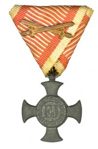 Figure 10: Iron Merit Cross on war ribbon with swords. Image from the author's archive.