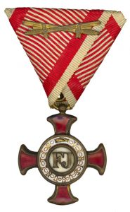 Figure 8: Gold Merit Cross on war ribbon with swords. Image from the author's archive.
