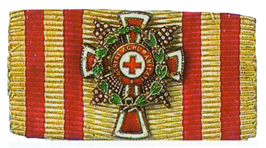 Figure 5: Red Cross ribbon with Merit Star with war decoration attachment. Image from the author's archive.