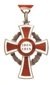 Figure 3: Red Cross Decoration with war decoration, second class, reverse. Image courtesy of Dorotheum