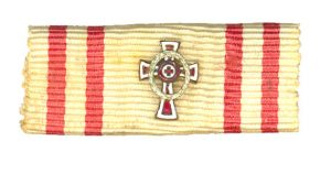 Figure 13: The small rectangular chest ribbon for this decoration sometimes issued with small attachments to indicate specific awards which was introduced in October 27,1917. Image form the author's archive.