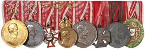Figure 18: Mounted group of 8 awards with the Silver Red Cross Merit Medal with war decoration at the far right position. Image from the author's archive.