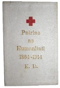 Figure 4: Red Cross Bronze Merit Medal with war decoration on Tri-fold ribbon box, exterior. Image from the author's archive.
