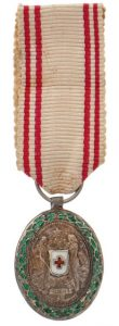 Figure 15: Miniature Silver Red Cross Merit Medal with war decoration. Image from the author's archive