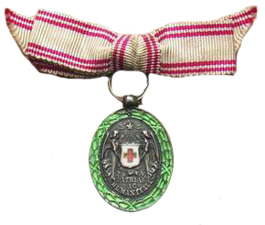 Figure 16: Silver Red Cross Merit Medal, miniature on civil bow. Image from the author's archive.