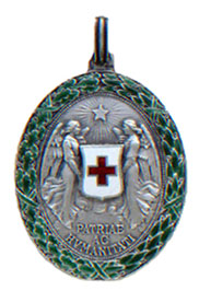 Figure 3: Silver Red Cross Decoration with war decoration, obverse.  Image from the author's archive.