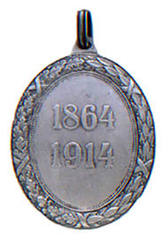 Figure 5: Silver Red Cross Merit Medal with war decoration, reverse.  Image from the author's archive.
