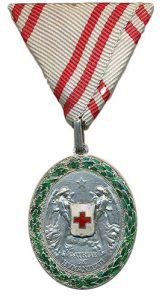 Figure 12: Red Cross Silver Merit Medal wiht war decoration on tri-fold ribbon. Image from the author's archive