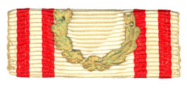 Figure 10: Red Cross ribbon with war decoration attachment . Image from the author's archive